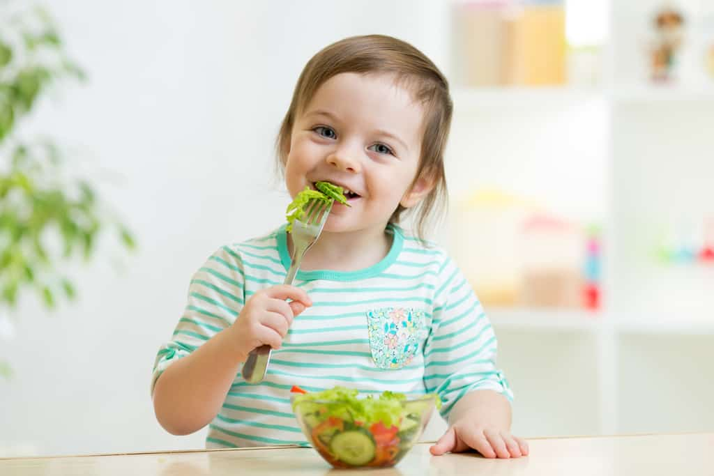 Child using a fork and spoon correctly