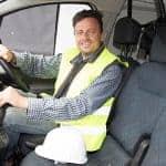 construction worker sat in a work van