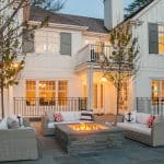 light gray shutters give a white house a modern appearance