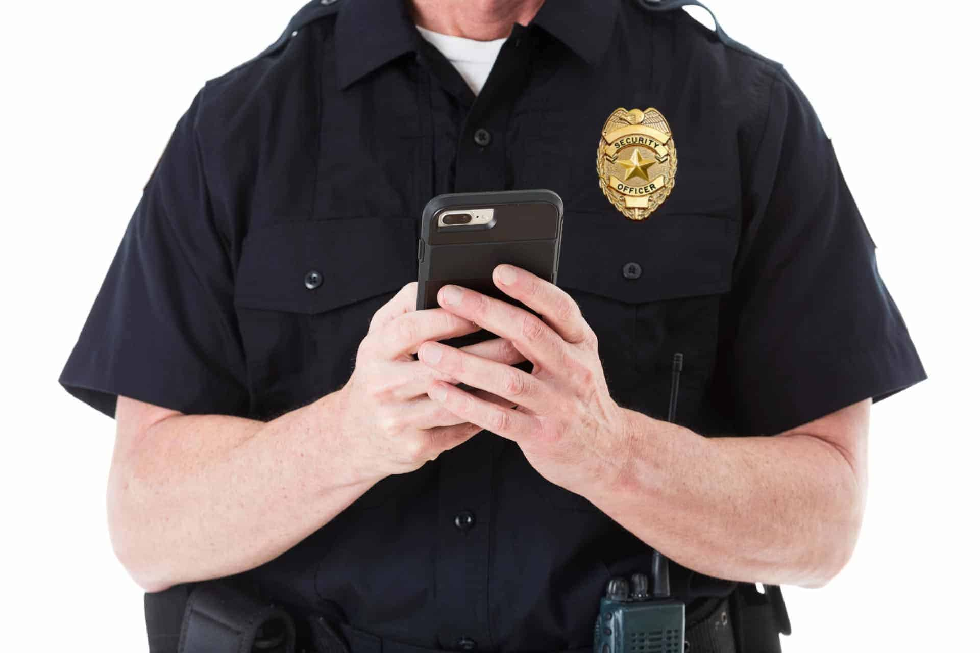 Security guard using mobile device to report