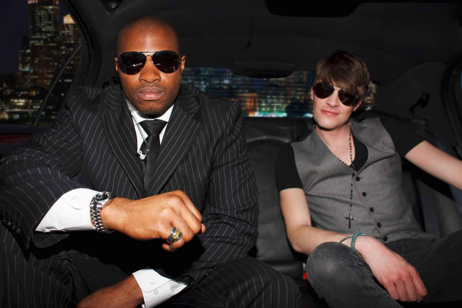Celebrity and bodyguard in a limo