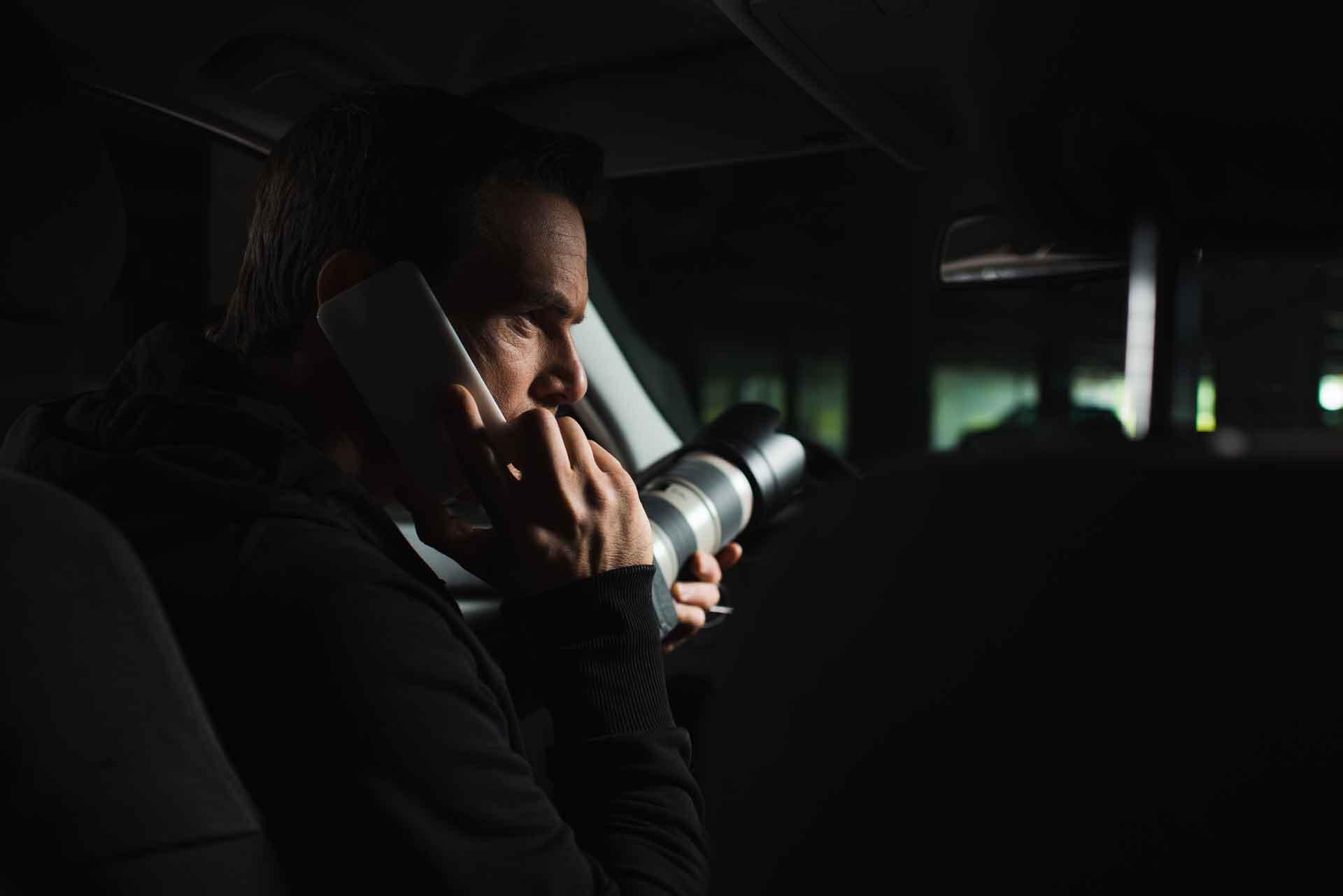 private investigator with a camera