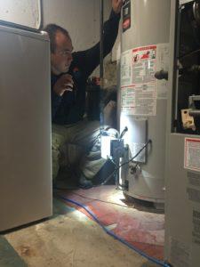 Inspecting Water Heater - BHI