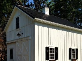 farmhouse two-story garage apartment with black metal roofing