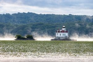 A photo of the Esopus Lighthouse as fog lifts off of the Hudson River on a June morning.