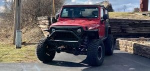 Red Jeep with lift kits installed