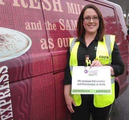 Field Service Engineer for Costa, Laura Angel, stood in front of a work van.