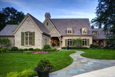 painted brick house exterior with mossy green shutters