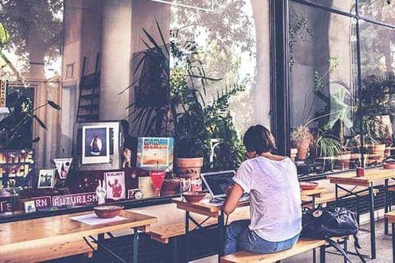 freelancer working in a cafe