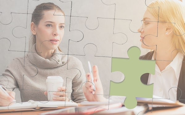 Customer retention jigsaw - a jigsaw puzzle made up of a client and business owner with missing piece