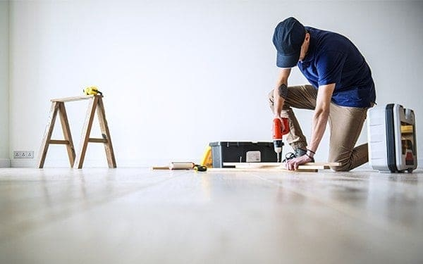 Tradesman completing job with tools on site