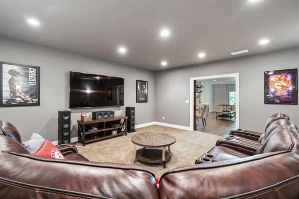 basement media room with cozy seating