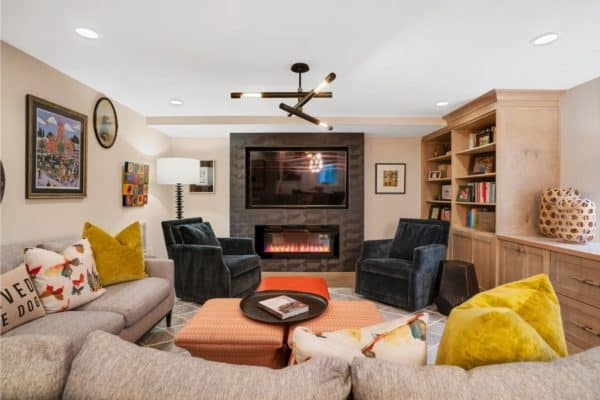 Cozy living space with electric fireplace in this finished basement.