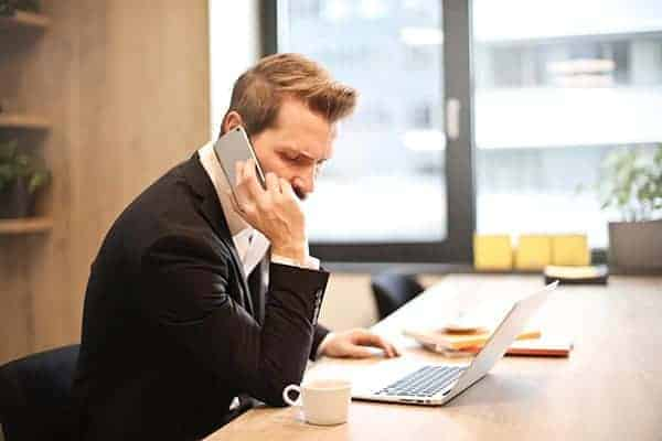 businessman on phone chasing money