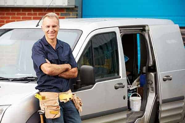 tradesman with his work van
