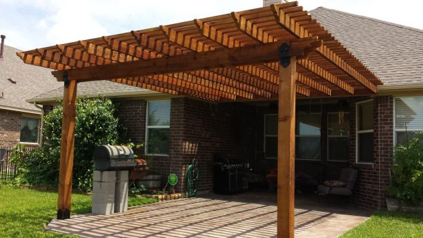 cedar pergola attached to a brown roof