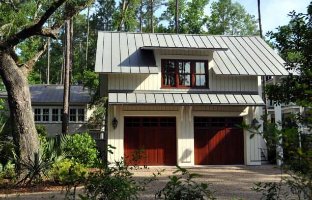 large traditional detached garage apartment with metal roof