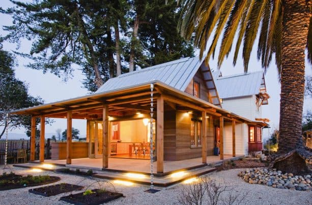 vintage victorian farmhouse with a metal roof and stained cedar siding combination