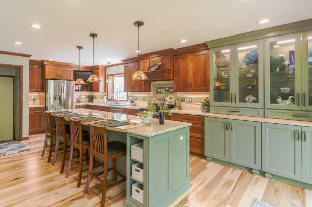 combination of wooden and sage green cabinets in a craftsman kitchen
