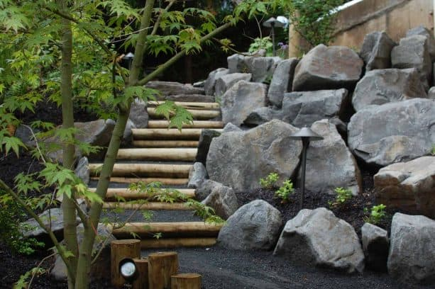 combination of wood and stone steps landscape to conquer steep slope