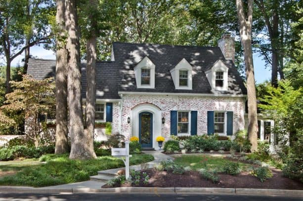 weathered brick house exterior with custom cape cod style shutters