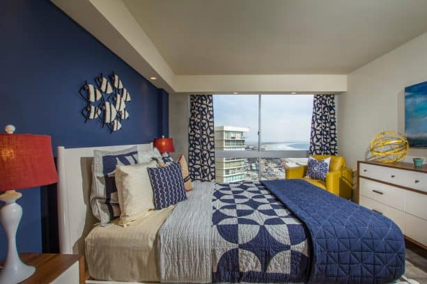 a denim wall and a standing-out canary chair for a cool coastal bedroom