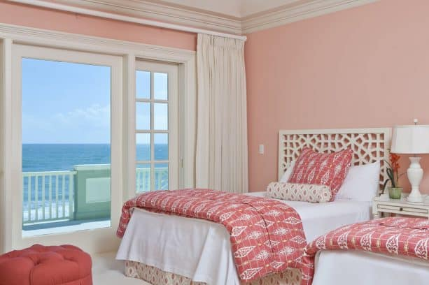 soft pink walls and pink bedding combine seamlessly with a white floor and bed