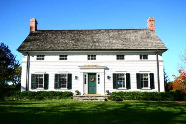 a farmhouse exterior will benefit from the addition of dark green shutters