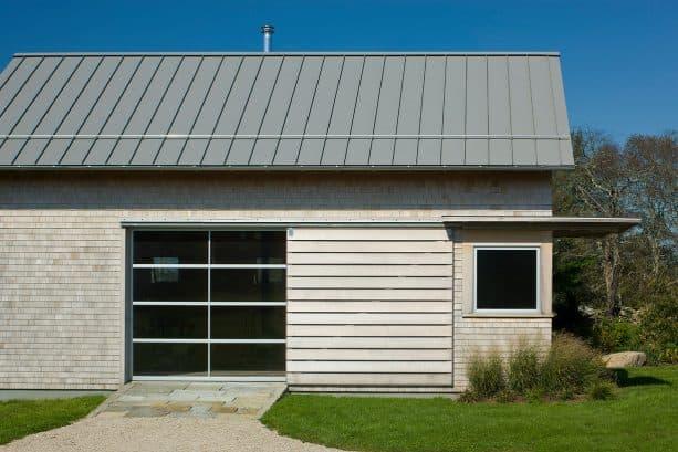 modern cottage garage apartment remodel with metal window and door
