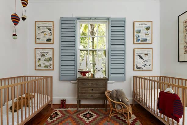 a traditional nursery interior design with light blue internal shutter and white wall