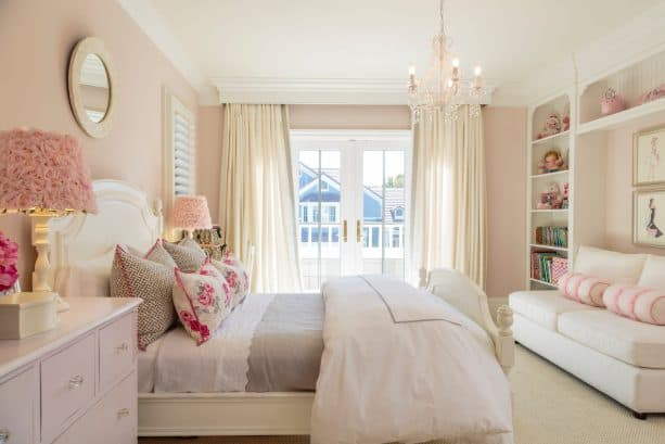 light pink walls and rosy lamp covers are perfect companions for a white bed