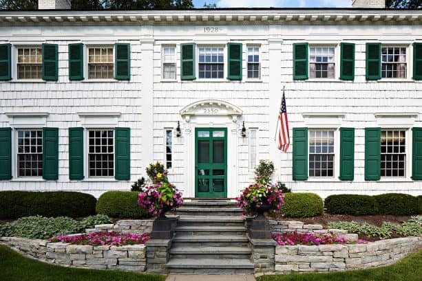 an elegant white house needs darker green shutters more than anything