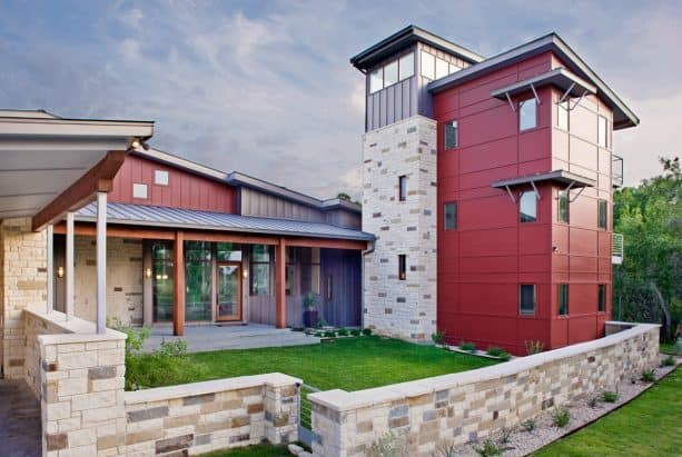 combination of cranberry red siding color and a metal roof in a modern house