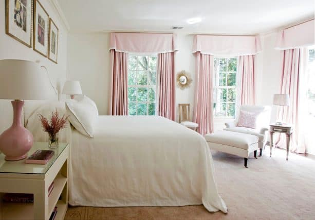 pink curtains and bedside table lamps make a cute bedroom