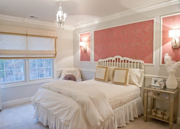 pink wallpapers inside box moulding give artistic values to a bedroom
