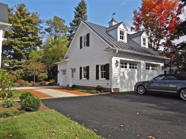 timeless three-car white garage apartment with englart metal black roof