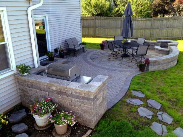 belgard stone paver patio with grill surround and fire pit