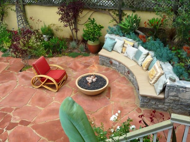 mid-sized tuscan backyard featuring stone paver patio and circular fire pit table