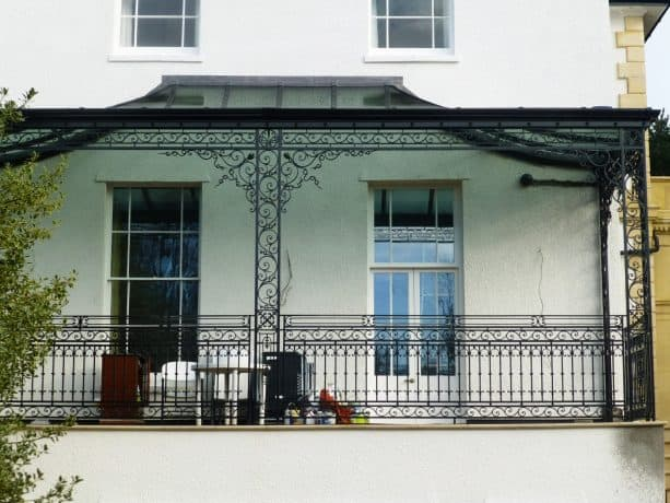 a classic porch should have classic-looking wrought iron columns