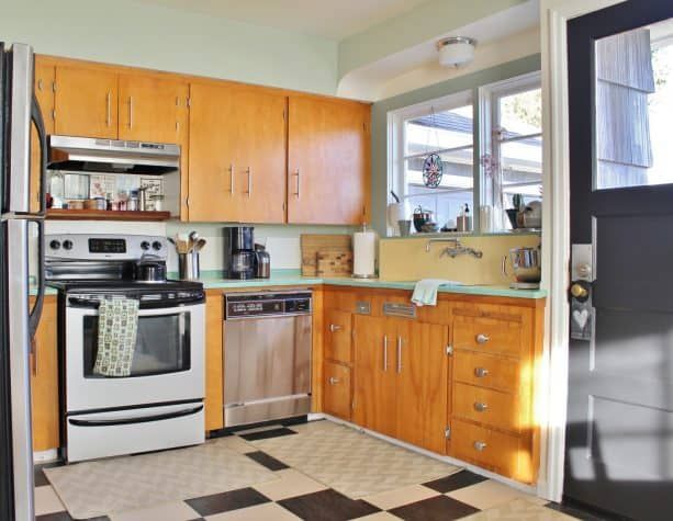 after remodel raised ranch kitchen with checkerboard floor tiles