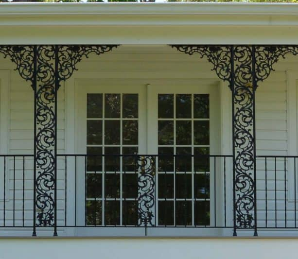 exquisite wrought iron columns suit the porch of a historic house perfectly
