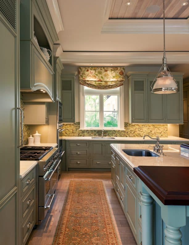 vintage kitchen with medium-toned wood floor and sage green cabinets