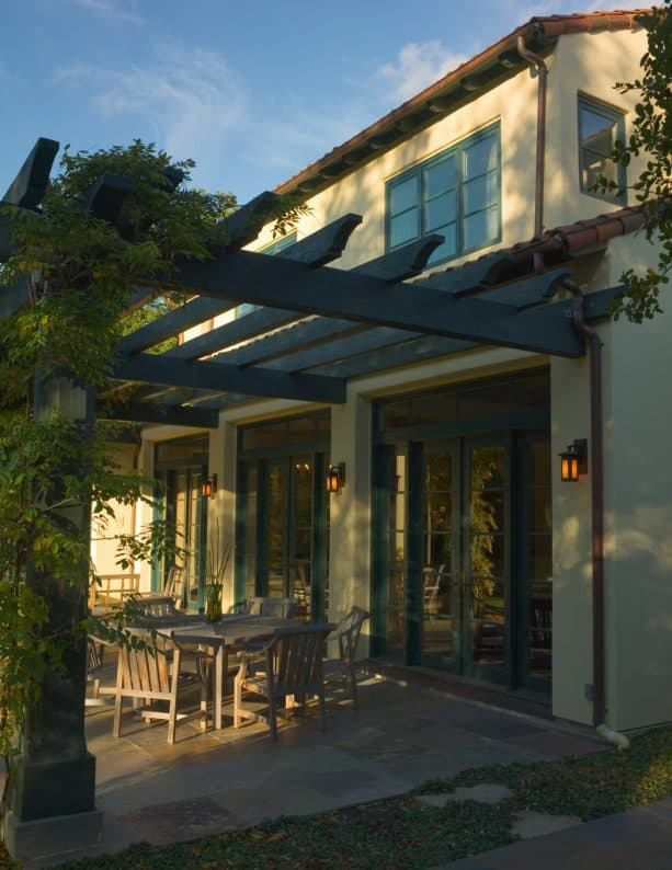tuscan style pergola attached to a copper roof