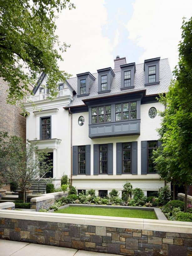 a white house with dark gray shutters looks so timeless