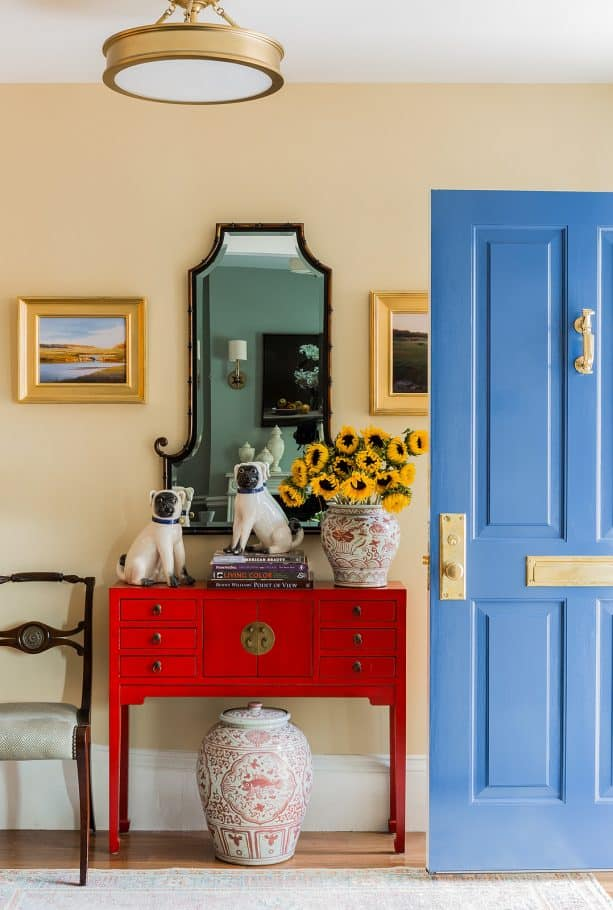 a welcoming delft blue fine paints of europe single front door with brass accents