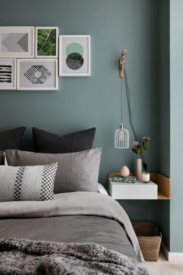 a Scandinavian bedroom designed with teal wall and fossil gray bed cotton