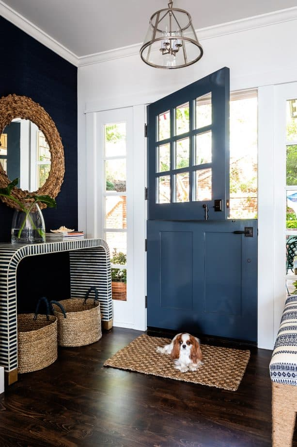 a dunn-edwards dark novelty navy blue front door that opens to beautiful sea views
