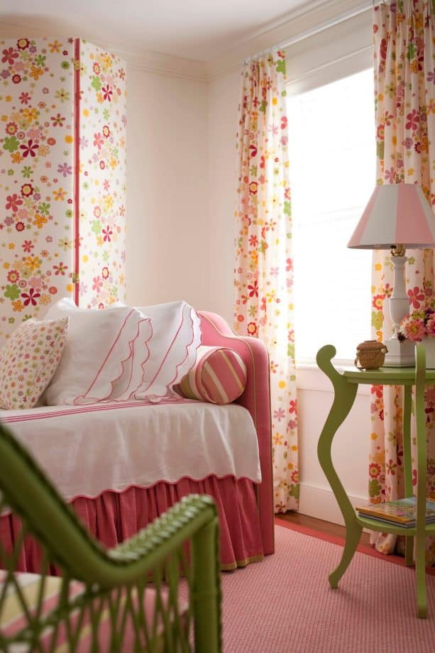 a pink bed and a matching carpet look astonishing in a bedroom with white walls