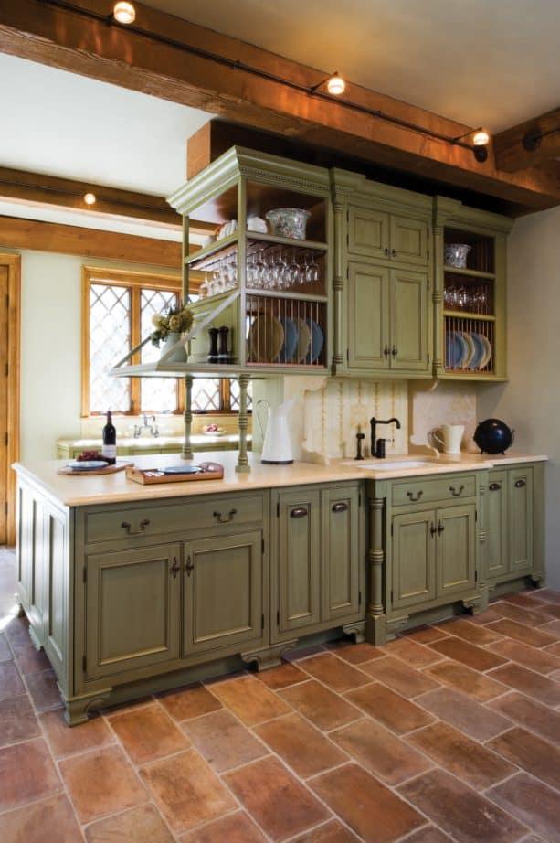 mediterranean kitchen featuring sage green beaded inset cabinets