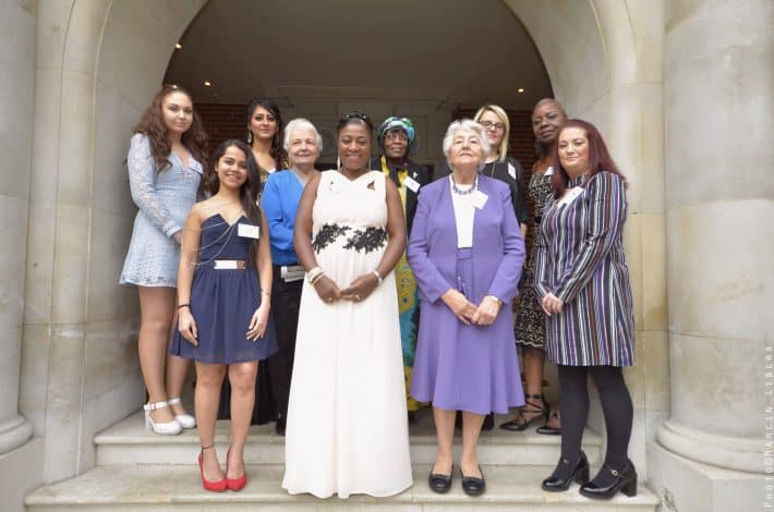 Award winners standing on steps at Amazing Women Global awards event